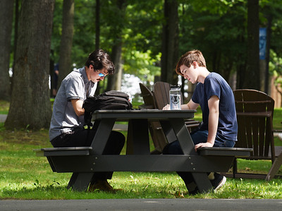 Freshman Scott Lefever of Slippery Rock and Samuel Pfeifer of Butler, both english majors at the Butler Community College took advantage of the weather to study outside Monday morning. Harold Aughton/Butler Eagle.