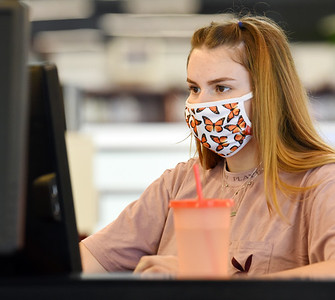 Second-year business administration student, Chloe Linamen of Emlenton spent time in the library during the first day of classes at BC3.  Students are required to wear masks inside while on campus.  Harold Aughton/Butler Eagle