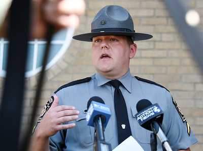 PSP trooper Josh Black addressed the media after a police shooting in the 300 block of West Jefferson Street Tuesday morning. According to trooper Black, Butler City resident John Ebberts, 35, was jumping in and out of traffic and acting erratically Tuesday morning.  Ebberts stabbed a responding Butler City police officer multiple times before the officer discharged his weapon fatally wounding Ebberts. Harold Aughton/Butler Eagle