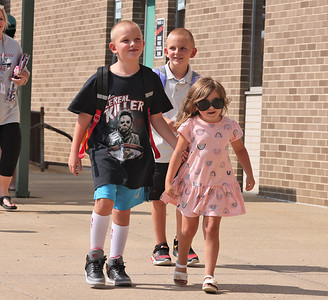 Clara Stahlman, 4, greets her cousins Jeric and Logan Stahlman, 7, after the first day of school at Slippery Rock Elementary School. Clara and her Aunt Faith Stahlman and mother Kellie Stahlman waited for the boys and their cousin Caleb Stahlman, 9. Seb Foltz/Butler Eagle 08/25/21