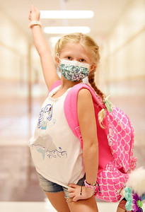 Third grader Bailey Costanza strikes a pose in the hallway of Rowan Elementary during the first day of school Wednesday morning. Harold Aughton/Butler Eagle.