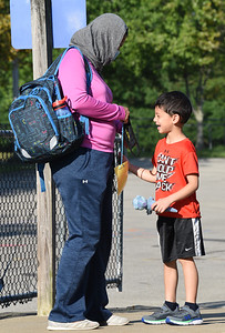 """Shai Hamad refered to her son, Omar, as a """"reluctant kindergartner,"""" as she dropped him off for the first day of school at Rown Elementary in Cranberry Twp. Wednesday morning. Harold Aughton/Butler Eagle."""
