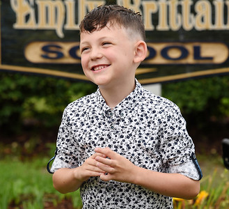 Dylan Dickey, a second grader at Emily Brittain Elementary, politely answers a reporter's questions during the first day of school Thursday morning. Harold Aughton/Butler Eagle