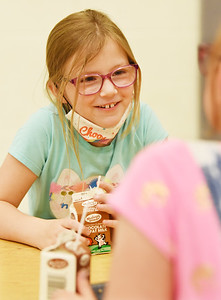 Third-grader Jessica Eberle socializes with classmate Charlotte Parker during lunch at Broad Street Elementary Thursday afternoon. Harold Aughton/Butler Eagle