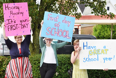 Staff members of the Butler Area Library, from left, Tiffany Harkleroad, Margaret Hewitt, and Lori Hinderliter welcomed students back to Emily Brittain Elementary during the first day of school Thursday morning.  Harold Aughton/Butler Eagle.