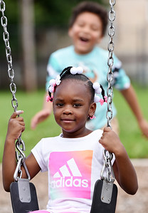 First-grader, Chyna Davis, got a little help from her classmate Kymani Nesbeth on the swing during recess at Broad Street Elementary Thursday afternoon. Harold Aughton/Butler Eagle