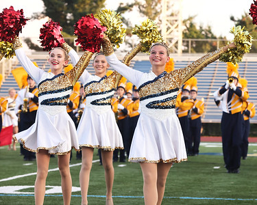 Marisa Shaffer (right) and Sophia Herring perform with the dance team and the Butler High School Marching Band during Thursday's pie festival fundraiser. Seb Foltz/Butler Eagle 08/26/21