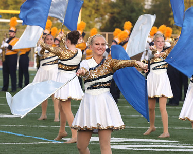 Melina Jack performs with the flag team and the Butler High School Marching Band at Thursday Night's Pie Festival fundraiser. Seb Foltz/Butler Eagle 08/26/21