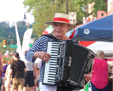Hank Edwardo walks Main St. playing Italian classics on the accordion Friday at Italian Fest. Seb Foltz/Butler Eagle 08/27/21