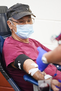 Joe Hotalski of South Buffalo Twp.  watches as donor specialist Marissa DeJohn of Vitalant draws blood from his arm at the Zion United Methodist Church in Sarver Thursday afternoon. Harold Aughton/Butler Eagle