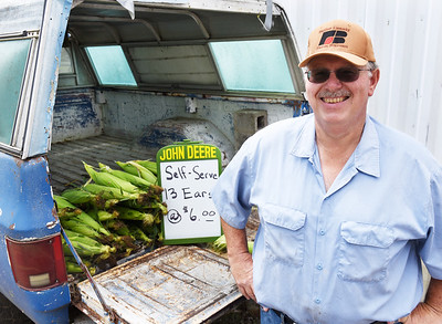 Farmer Dennis Bryan of Fairview Township relies on the honor system to sell sweet corn out of his 1978 Chevy pickup. His family has been selling sweet corn since the early 1960s.  Harold Aughton/Butler Eagle