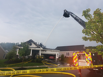 Cranberry Township Volunteer Fire Company sprayed a house on the 200 block of Jefferson Lane to extinguish a fire likely caused by a lightning strike Sunday. EDDIE TRIZZINO/BUTLER EAGLE