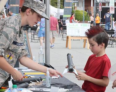 Civil Air Patrol cadet Matthew White, 14, helps Tommy Hoffman,7, build a foam sling shot rocket at the air patrol booth at Mars Exploration Celebration Saturday. Seb Foltz/Butler Eagle 08/30/21