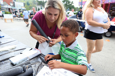 Cole Iheagwara, 4, builds a foam rocket with his mother Becky at the Civil Air Patrol booth at Mars Exploration Celebration Saturday. 08/30/21