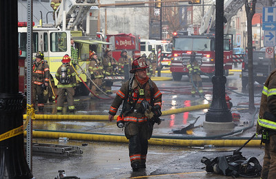 A fire fighter walks down Main Street during the response to a fire that allegedly started at Sir Speedy. Fire crews from across the region responded to the fire  Saturday. Seb Foltz/Butler Eagle 01/30/21