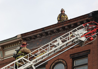 Fire fighters tackle hot spots on in Saturday's Main Street fire at Sir Speedy copy center. Fire crews from across the region responded to the fire which allegedly started in the back of Sir Speedy copy center. Seb Foltz/Butler Eagle 01/30/21