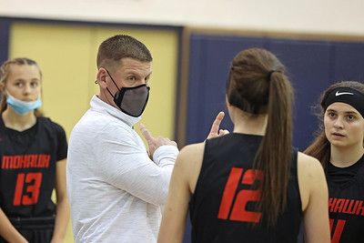 Mohawk girls basketball coach and Knoch grad Mike O'Lare coaches players during a timeout against Butler Saturday. Seb Foltz/Butler Eagle 01/31/21