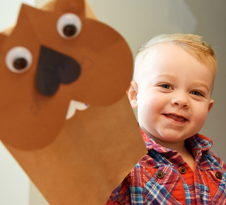 """Wesley Boland, 2, shows off his groundhog hand puppet made from a """"Take and Make"""" craft bag from the Mars Library. Friday, January 29, 2021. Harold Aughton/Butler Eagle."""