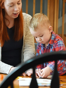 """Wesley Boland, 2, works on his groundhog hand puppet with his mother, Caitlyn Boland, Mars library director, which they made from a """"Take and Make"""" craft bag from the Mars Library. Friday, January 29, 2021. Harold Aughton/Butler Eagle."""