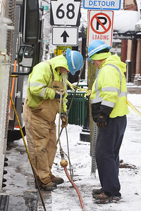 Workers from the Pennsylvania Water Company turned off the water to the buildings affected by Saturday's fire on South Main Street in Butler, Monday morning, February 1, 2021. Harold Aughton/Butler Eagle.