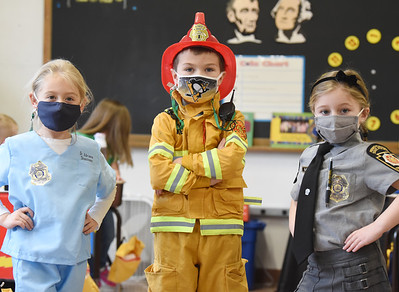 Kindergartners (from left) Adrianna Shasteen, dressed as a doctor; Heath Zabkar, dressed as a fireman, and Olivia Black, dressed as a Pennsylvania State Trooper in recognition of Healthcare and First Responder Appreciation Day at Butler Catholic.
