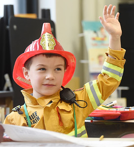 Kindergartner Heath Zabkar, dressed as a fireman in recognition of Healthcare and First Responder Appreciation Day at Butler Catholic.