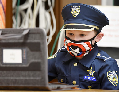 Third grader, Atticus English, dressed as a policeman in recognition of Healthcare and First Responder Appreciation Day at Butler Catholic. February 2, 2021. Harold Aughton/Butler Eagle.
