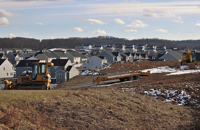 Construction vehicles sit idle where the Sienna Village development is to be located along Route 228, part of the Weatherburn Heights neighborhood in Middlesex Township. Seb Foltz/Butler Eagle 01/21/21
