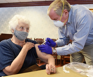 Retired physician, Dr. Frank Brown, vaccinates Concordia Haven resident Jean Stickley, 85, Wednesday afternoon. Saxonburg Drug distributed the Moderna vaccine to 60 residents of the Concordia Haven apartments.   February 3, 2021. Harold Aughton/Butler Eagle.