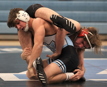 Seneca Valley's Dylan Chappell lifts West Allegheny's Camden Harbert in the 132-pound weight class in Wednesday night's match at Seneca. Chappell won the match, contributing to the Seneca win. Seb Foltz/Butler Eagle 02/03/21