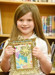 Butler Catholic kindergartener Adelle Crouse, 5, works on an art project for Valentine's Day. The cards will be framed and presented to nursing home residents. Harold Aughton/Butler Eagle.