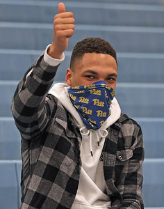 Class of 2018 Seneca alum and former wrestler Louis Newell gives the thumbs up to Seneca's Alejandro Herrera-Rondon. Herrera-Rondon surpassed Newel's school record for wins with a forfeit win Wednesday against West Allegheny. The win was Herrera-Rondon's 157th. Seb Foltz/Butler Eagle 02/03/21