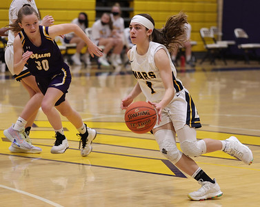 Mars' Alexa McDole(1) drives to the hoop against Plum Thursday. Mars fell to Plum 45-43 in the final seconds of the game. Seb Foltz/Butler Eagle 02/04/21  Note: Plum #30