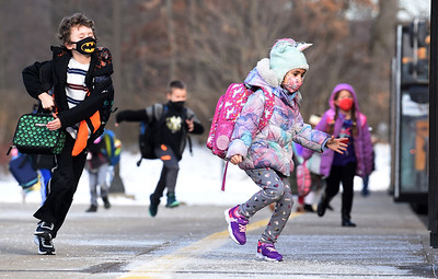 Students from the Mars Primary Center rush to catch the bus Thursday afternoon, Feb. 4, 2021. Harold Aughton/Butler Eagle.