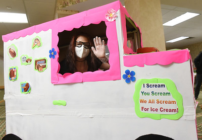 Activities Assistant, Tiffany Steiner, delivers ice cream in Concordia's homemade ice-cream truck that which maintenance workers made out of a scooter. Harold Aughton/Butler Eagle.