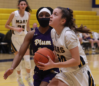Mars Olivia Donnelly (30) drives to the hoop against Plum's Kai Johnson Thursday. Mars fell to Plum 45-43 in the final seconds of the game. Seb Foltz/Butler Eagle 02/04/21