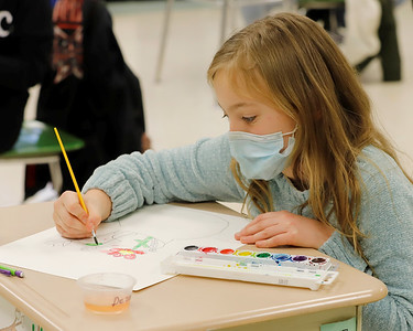 Northwest Elementary fourth grader Dezarae Walter, 9, works on an water color project in Gretchen Lavery's art class Friday. Seb Foltz/Butler Eagle 01/22/21