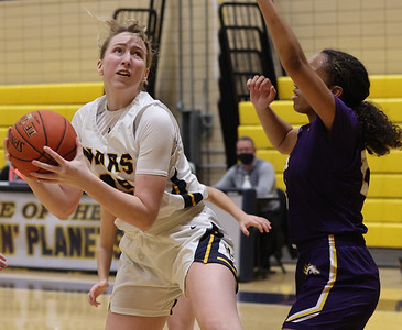 Mars'  Lauren Atwell (45) takes a shot against Plum's Kennedie Montue (21). The Planet's fell to Plum 45-43  in the final seconds of the game. Seb Foltz/Butler Eagle 02/04/21