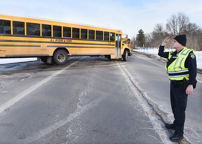 Adams Twp. patrol officer Ian Ging directs traffice at the Mars Primary School along Route 228 Thursday afternoon, Feb. 4, 2021. Harold Aughton/Butler Eagle.