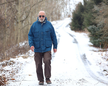 Chalrlie McChesney,81, of Mars walks down his driveway. He credits walking and jogging for keeping him fit into his 80s. Seb Foltz/Butler Eagle 01/29/21