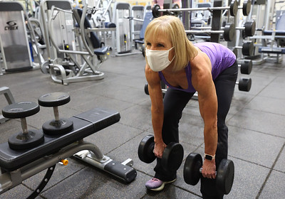 Rose E. Schneider YMCA member Debbie Gallagher,62, lifts weights, her routine includes a variety of dumbel lifts from 30 to 45 pounds each. Seb Foltz/Butler Eagle 01/28/21