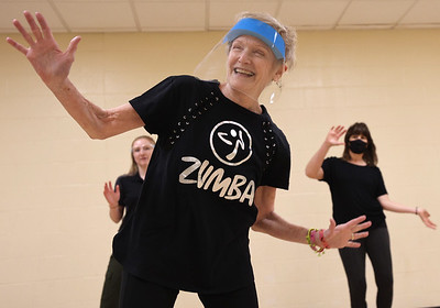 Rose E. Schneider YMCA fitness instructor Sandy Wargo, 72, leads a Zumba class. Seb Foltz/Butler Eagle 01/28/21