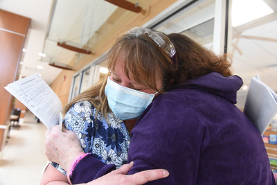 RN Stacey Heider embraces Karen Rich of Franklin Twp., the first patient to survive COVID-19 at the Butler Hospital  Monday, February 8, 2021. Harold Aughton/Butler Eagle.