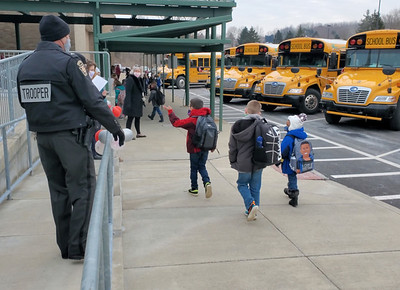 A state trooper waved to students at Slippery Rock Area Elementary School on February 8, 2021, to help kickoff the school's Kindness Week. Photo by Nathan Bottiger/Butler Eagle