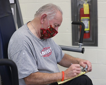 Rose E. Schneider YMCA member Gail Davis, 76, tracks his workout numbers. Seb Foltz/Butler Eagle 01/28/21