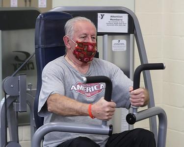 Rose E. Schneider YMCA member Gail Davis, 76, lifts weights. Seb Foltz/Butler Eagle 01/28/21