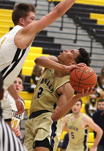 Butler's Devin Carney takes a foul from North Allegheny's Greg Habib in Butler's 81-74 loss at NA Wednesday. Seb Foltz/Butler Eagle 02/10/21