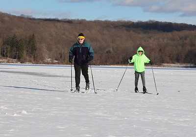 Jay Tindall of Harmony and his son Christopher cross country ski along the South Shore of Lake Arthur at Moraine State Park earlier this week. Seb Foltz/Butler Eagle Feb 2021