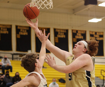 Butler's Kaleb Proudfoot reaches for a layup against North Allegheny in Butler's 81-74 loss at NA Wednesday. Seb Foltz/Butler Eagle 02/10/21