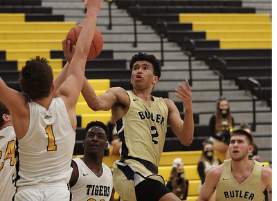 Butler's Devin Carney reaches for a layup against North Allegheny's Greg Habib in Butler's 81-74 loss at NA Wednesday. Seb Foltz/Butler Eagle 02/10/21